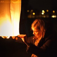 Girl lights a Chinese Lantern at mass launch on the Bristol Downs to celebrate Chinese New Year