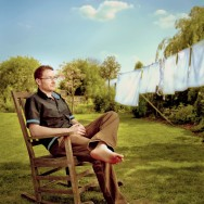 environmental portrait of a man in a chair in the garden