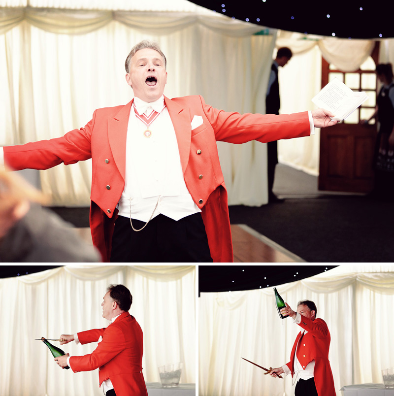toastmaster in tortworth court marquee opens champagne with a sword